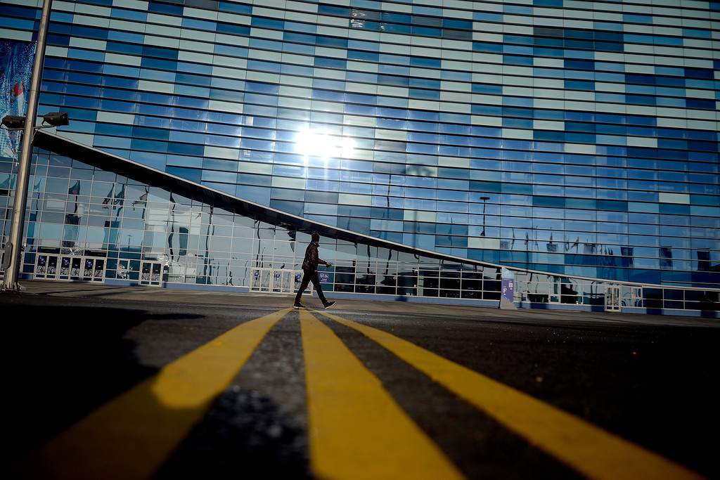 . A visitor walks in front of the Iceberg Skating Palace during opening weekend at the Olympic village at the Sochi 2014 Winter Olympics on Saturday, February 8, 2014. (Photo by AAron Ontiveroz/The Denver Post)