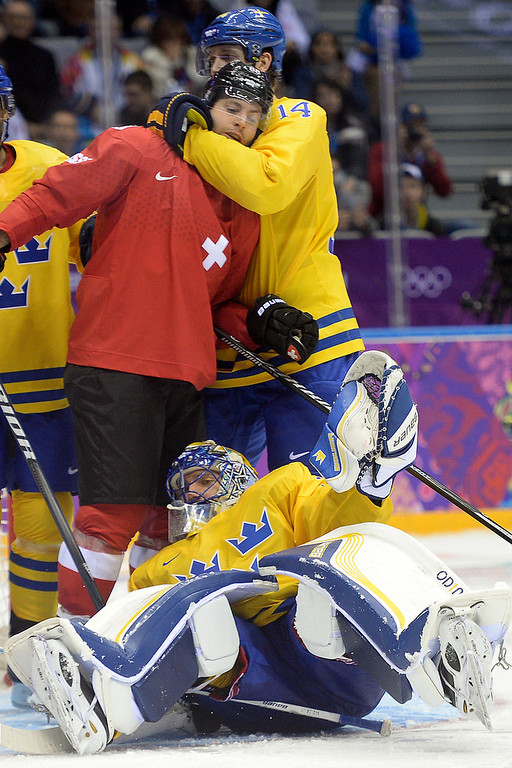 . Sweden\'s Patrik Berglund wraps Switzerland\'s Kevin Romy up around the neck after he made contact with goalie Henrik Lundqvist during the third period of Sweden\'s 1-0 preliminary round group C win at Bolshoy Arena. Sochi 2014 Winter Olympics on Friday, February 14, 2014. (Photo by AAron Ontiveroz/The Denver Post)