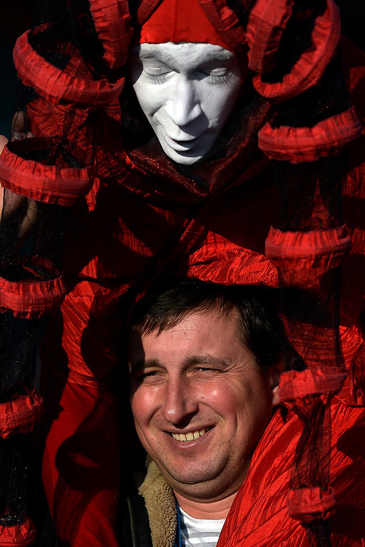 . Russian street performers entertain crowds of visitors during opening weekend at the Olympic village on Saturday, February 8, 2014. (Photo by AAron Ontiveroz/The Denver Post)