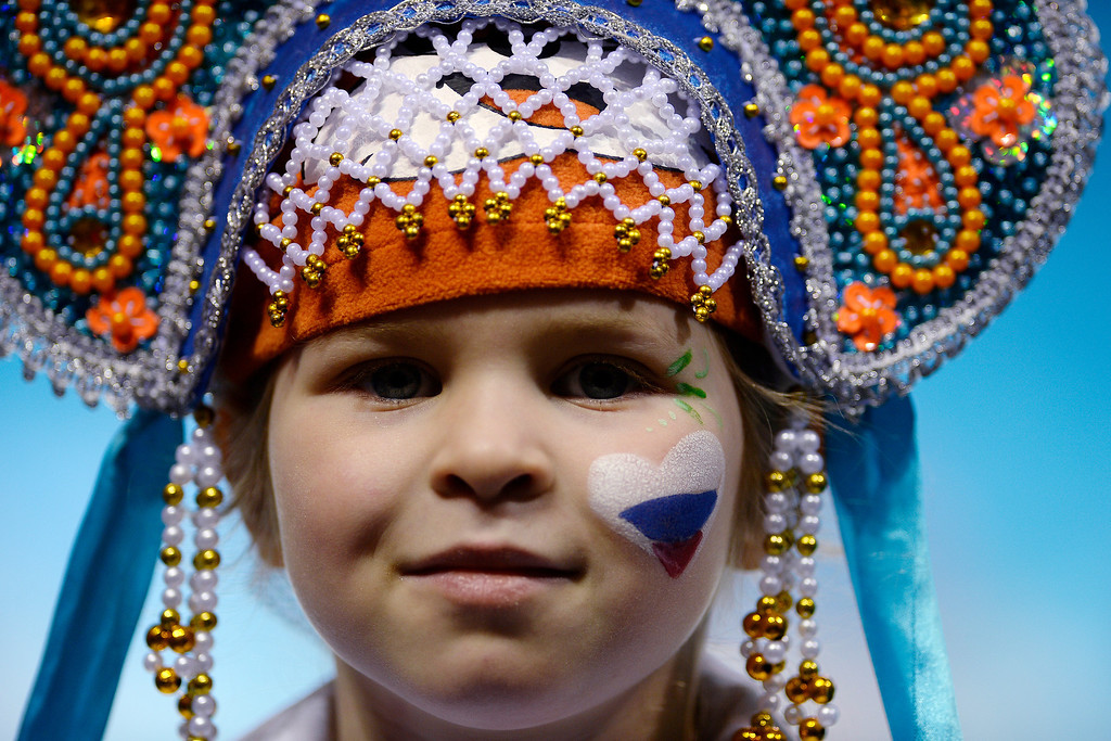 . Team Russian fan Eba, 4, watches the action during a women\'s curling qualifier at the Ice Cube Curling Center.  (Photo by AAron Ontiveroz/The Denver Post)