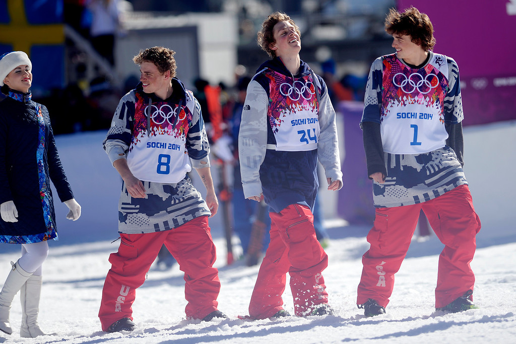 . U.S.A. medalists from left to right, Gus Kenworthy (silver), Joss Christensen (gold) and Nick Goepper (bronze) walk to the podium after the men\'s ski slopestyle final at the Rosa Khutor Extreme Park. (Photo by AAron Ontiveroz/The Denver Post)