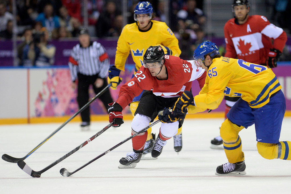 . Jamie Benn (22) of Canada controls the puck as Erik Karlsson (65) of Sweden pursues during the third period of Canada\'s 3-0 win in the men\'s ice hockey gold medal game against Sweden. Sochi 2014 Winter Olympics on Sunday, February 23, 2014 at Bolshoy Ice Arena. (Photo by AAron Ontiveroz/ The Denver Post)