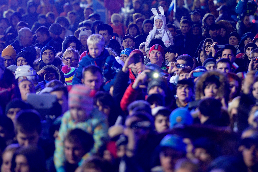 . Fans watch the presentation during the medals ceremony for the men\'s skeleton. Sochi 2014 Winter Olympics on Sunday, February 16, 2014. (Photo by AAron Ontiveroz/The Denver Post)