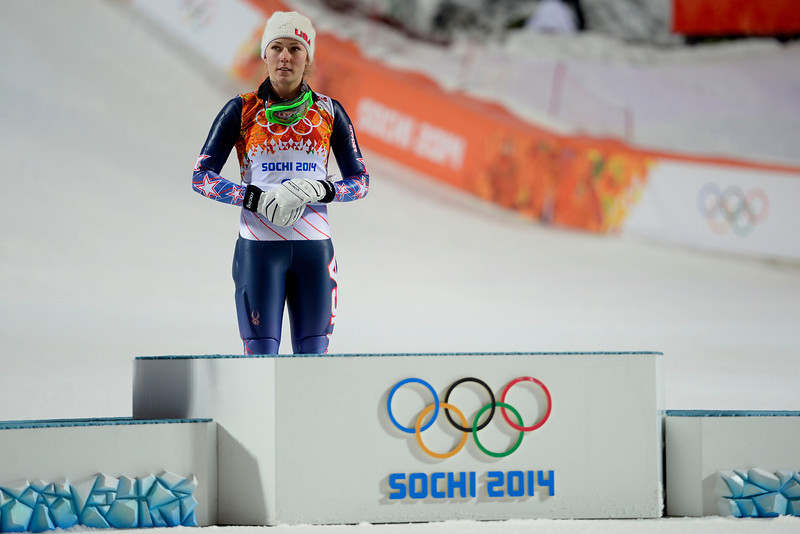 . Gold medalist American Mikaela Shiffrin prepares to take the podium as silver medalist Marlies Schild and bronze medalist Kathrin Zettel (both of Austria) are announced after ladies\' slalom run 2. Sochi 2014 Winter Olympics on Friday, February 21, 2014 at Rosa Khutor Alpine Center. (Photo by AAron Ontiveroz/ The Denver Post)