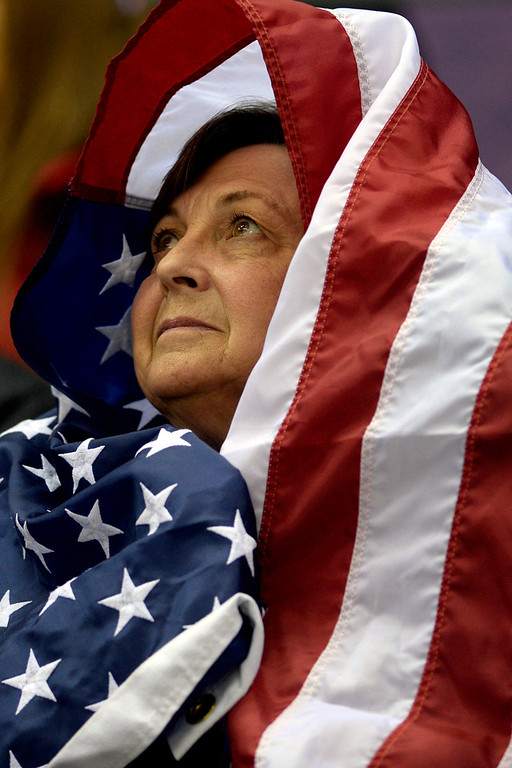 . An American fan wraps herself in a flag before the start of the shootout between the U.S.A. and Russia during  the U.S.A.\'s shootout-win at Bolshoy arena. Sochi 2014 Winter Olympics on Saturday, February 15, 2014. (Photo by AAron Ontiveroz/The Denver Post)