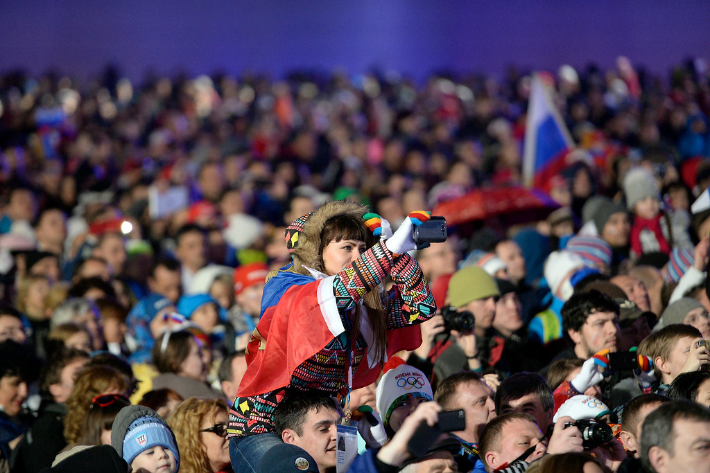 . Fans watch the presentation during the medals ceremony for the men\'s skeleton at the Sochi 2014 Winter Olympics on Sunday, February 16, 2014. (Photo by AAron Ontiveroz/The Denver Post)