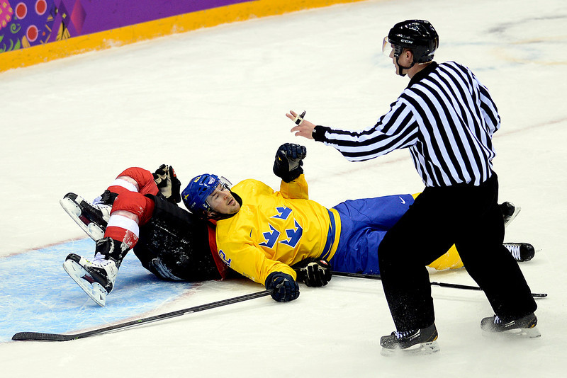 . Sweden\'s Jimmie Ericsson looks at the referee after taking Switzerland\'s Julien Vauclair to the ice during the action at Bolshoy Arena. Sochi 2014 Winter Olympics on Friday, February 14, 2014. (Photo by AAron Ontiveroz/The Denver Post)
