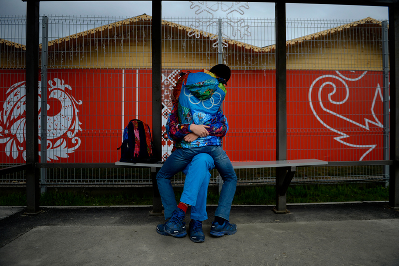 . A man straddles a woman as they kiss on a bus bench during a stroll through the neighborhoods surrounding Adler, Russia. Sochi 2014 Winter Olympics on Wednesday, February 19, 2014. (Photo by AAron Ontiveroz/ The Denver Post)