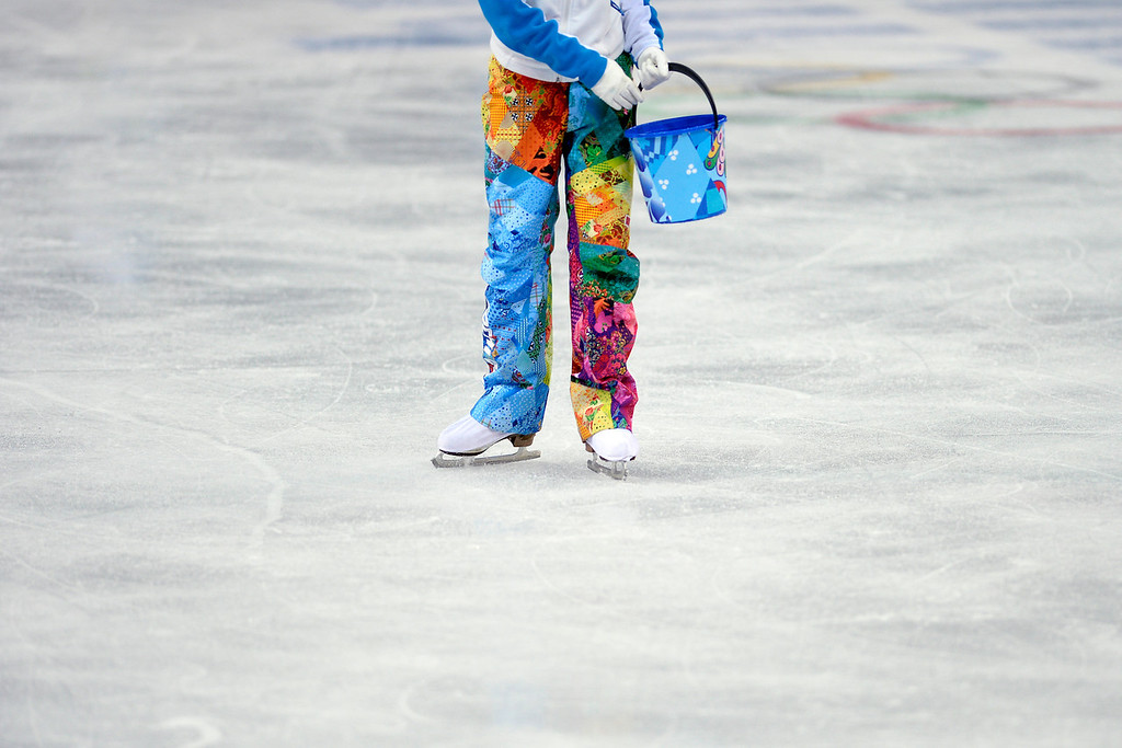 . Volunteers repair the ice during team figure skating suring the Sochi 2014 Winter Olympics on Saturday, February 8, 2014. (Photo by AAron Ontiveroz/The Denver Post)