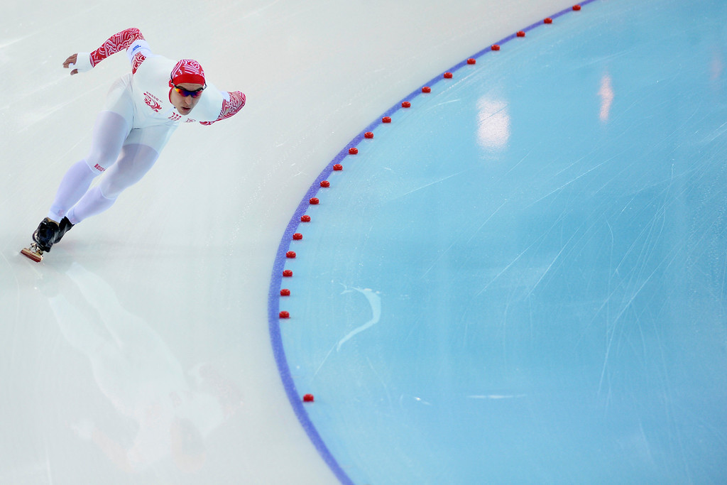. Russia\'s Dmitry Lobkov makes his first turn during the speed skating men\'s 500-meter at Adler Arena during the Sochi 2014 Winter Olympics on Monday, February 10, 2014. (Photo by AAron Ontiveroz/The Denver Post)