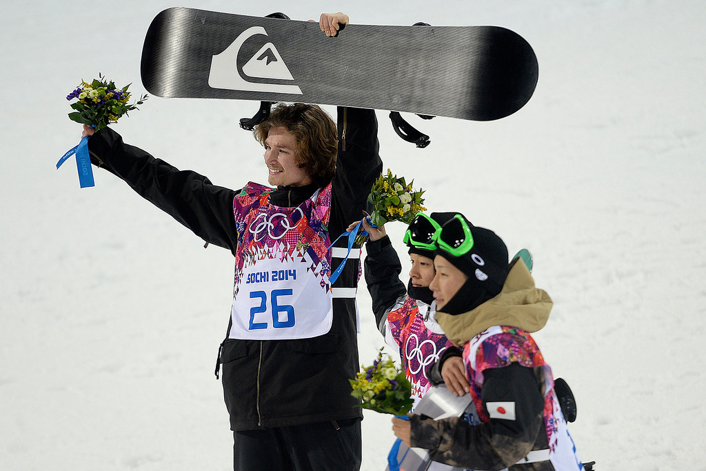 . Gold medalist Iouri Podladtchikov raises his board on the podium during the men\'s snowboard halfpipe final during the Sochi 2014 Winter Olympics on Tuesday, February 11, 2014. (Photo by AAron Ontiveroz/The Denver Post)