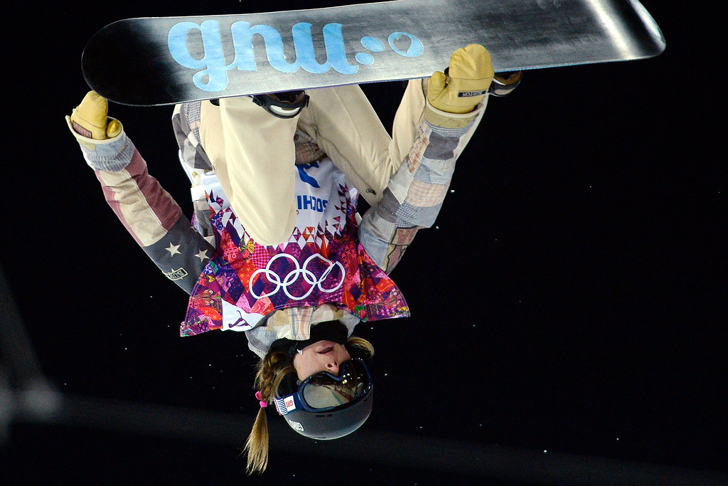 . Kaitlyn Farrington of the U.S. makes a run during a women\'s snowboard halfpipe final at the Rosa Khutor Extreme Park on Wednesday, February 12, 2014. (Photo by AAron Ontiveroz/The Denver Post)