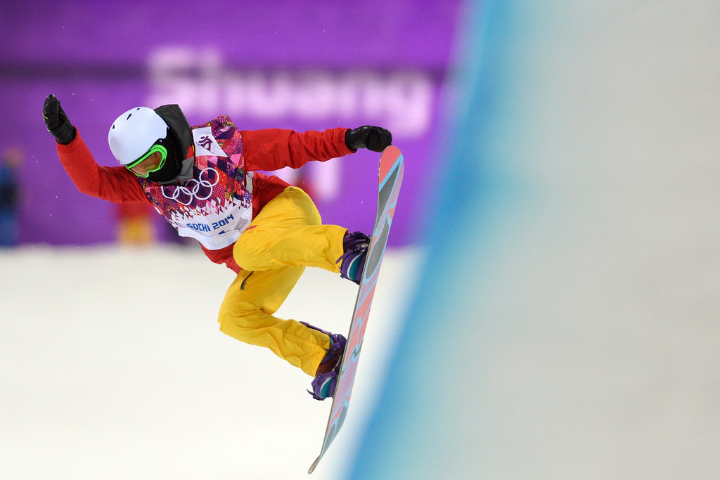 . China\'s Li Shuang rotates during a women\'s snowboard halfpipe final at the Rosa Khutor Extreme Park. Sochi 2014 Winter Olympics on Wednesday, February 12, 2014. (Photo by AAron Ontiveroz/The Denver Post)