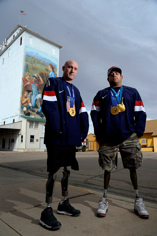 . U.S.A. Paralympics sled hockey gold medalists Tyler Carron (left) and Nikko Landeros in Berthoud, Colorado on Thursday, March 20, 2014. (Photo by AAron Ontiveroz/The Denver Post)
