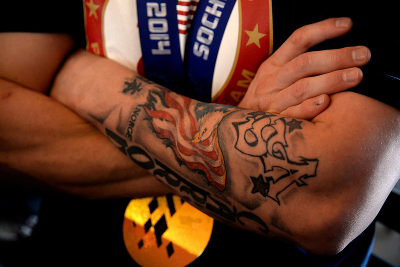 . With his hardware around his neck, U.S.A. Paralympics sled hockey gold medalist Tyler Carron rocks a new tattoo that chronicles his worldwide journeys with teammate and fellow Berthoud native Nikko Landeros. Carron and Landeros were high school wrestling teammates at Berthoud High School when they were hit by a fellow student while changing a flat tire resulting in the amputation of their legs in 2007. Berthoud, Colorado on Thursday, March 20, 2014. (Photo by AAron Ontiveroz/The Denver Post)