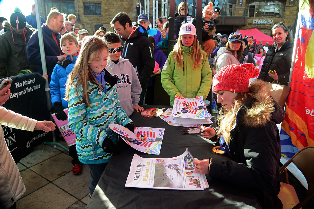 . VAIL, CO. - MARCH 28: Olympian Mikaela Shiffrin signs a poster for Kate Bell, 10, at a welcome home celebration held for Shiffron in Vail by the town of Vail, Vail Valley Foundation and Vail Resorts, March 28, 2014. The now 19-year-old Shiffrin became the youngest Slalom champion in Olympic Alpine Skiing history, with her .53 victory in Sochi over Austria\'s Marlies Schild. (Photo By Mahala Gaylord/The Denver Post)