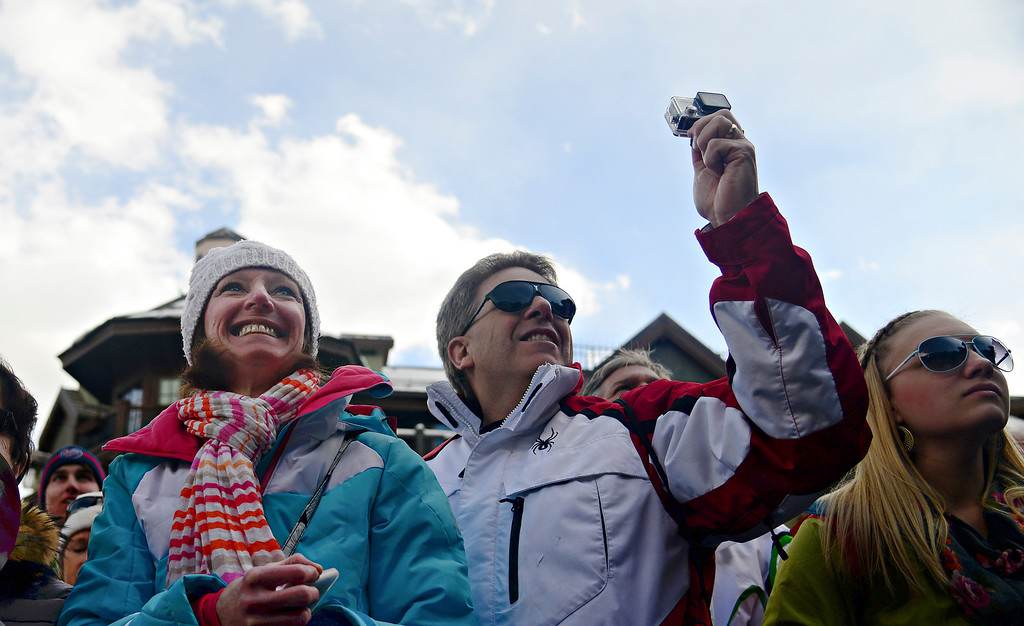""". VAIL, CO. - MARCH 28: Kathy Carter, center, of Arlington Heights, IL, grins and tears up as she participates in a welcome home celebration for Olympian Mikaela Shiffrin in Vail, March 28, 2014. The now 19-year-old Shiffrin became the youngest Slalom champion in Olympic Alpine Skiing history, with her .53 victory in Sochi over Austria\'s Marlies Schild. \""""It\'s amazing. I watched her on the Olympics and it makes me so excited to see a great kid do so well.\"""" said Carter. (Photo By Mahala Gaylord/The Denver Post)"""