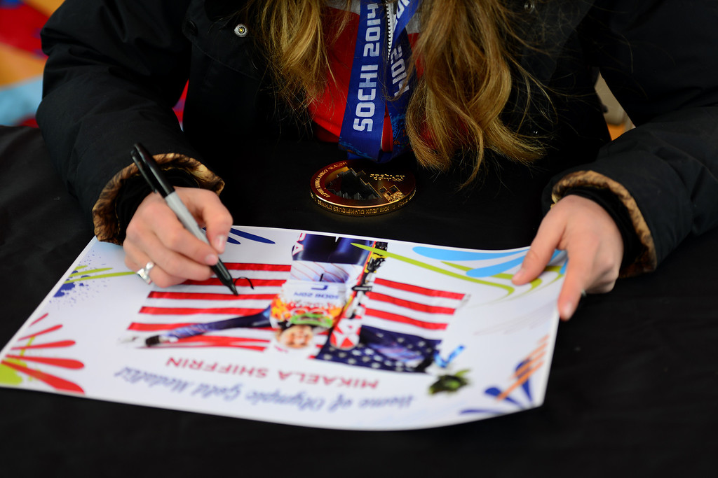 . VAIL, CO. - MARCH 28: Olympian Mikaela Shiffrin signs posters at a welcome home celebration held in her honor in Vail by the town of Vail, Vail Valley Foundation and Vail Resorts, March 28, 2014. The now 19-year-old Shiffrin became the youngest Slalom champion in Olympic Alpine Skiing history, with her .53 victory in Sochi over Austria\'s Marlies Schild. (Photo By Mahala Gaylord/The Denver Post)