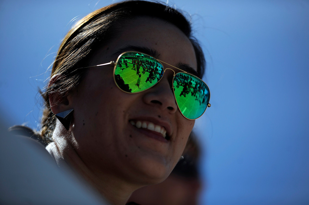 . Tessa Ochs, of Iowa, watches as more than 50,000 people run through Folsom Field on the University of Colorado campus to finish the 36th Annual Bolder Boulder 10K road race on Memorial Day, May 26, 2014. (Photo By Lindsay Pierce/The Denver Post)