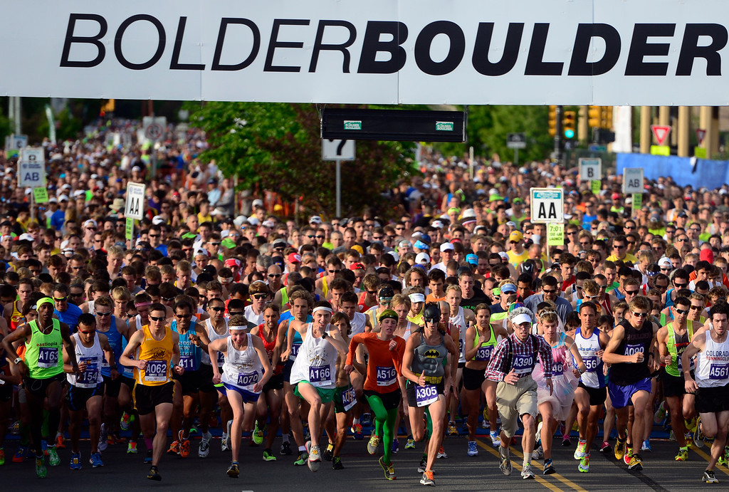 . The first wave of runners takes off from the starting line with over 50,000 racers registering this year. The 36th BolderBoulder takes place on the streets of Boulder, CO on Memorial Day, May 26, 2014. The 10K event brings winds through the streets of Boulder and finishes at Folsom Field on the University of Colorado campus. (Kathryn Scott Osler, The Denver Post)