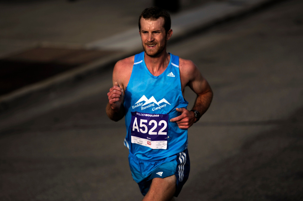 . Scott Dahlberg, of Ft. Collins, maintains the lead during the 36th Annual Bolder Boulder 10K road race on Memorial Day, May 26, 2014. (Photo By Lindsay Pierce/The Denver Post)