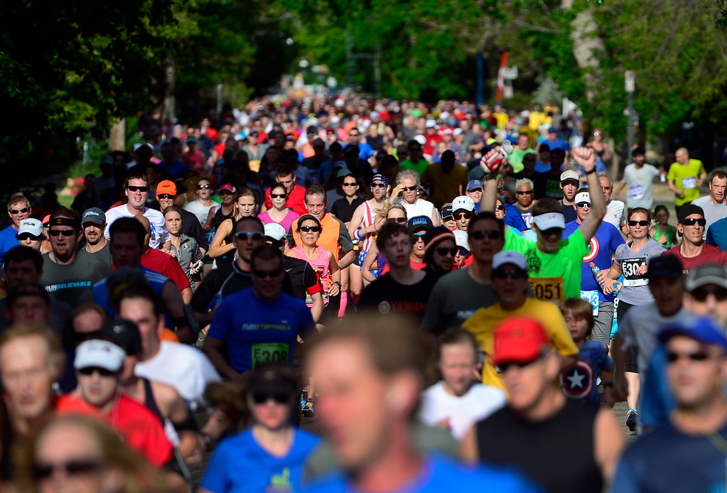 . Runners crowd Walnut Street as they reach about a mile to the finish line. The 36th BolderBoulder takes place on the streets of Boulder, CO on Memorial Day, May 26, 2014. The 10K event brings winds through the streets of Boulder and finishes at Folsom Field on the University of Colorado campus. (Kathryn Scott Osler, The Denver Post)