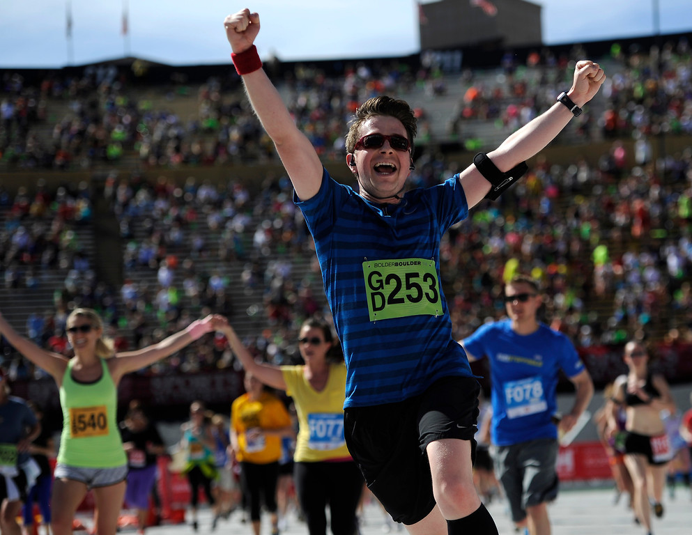. Jason Sellers, of Colorado Springs crosses the finish line of the 36th Annual Bolder Boulder 10K road race at Folsom Field on the University of Colorado campus, Memorial Day, May 26, 2014. (Photo By Lindsay Pierce/The Denver Post)