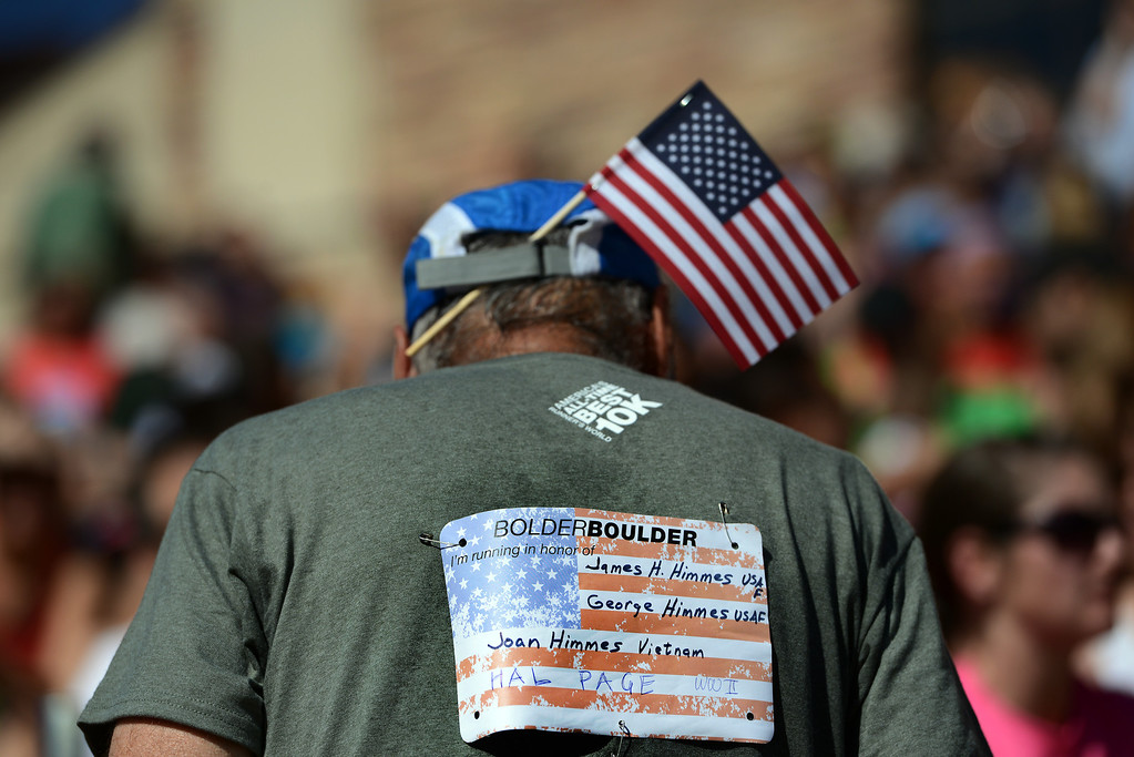 . Many of the more than 50,000 runners at the 36th Annual BolderBOULDER 10K road race, ran in honor of a United States service member or veteran on Memorial Day, May 26, 2014.  (Photo By Lindsay Pierce/The Denver Post)
