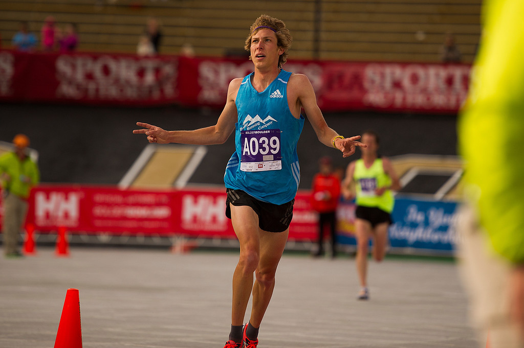 . Andy Wacker, a former runner at the University of Colorado, finishes second in the 2014 BolderBoulder 10K citizens race at Folsom Field on May 26, 2014, in Boulder, Colorado. (Photo by Daniel Petty/The Denver Post)