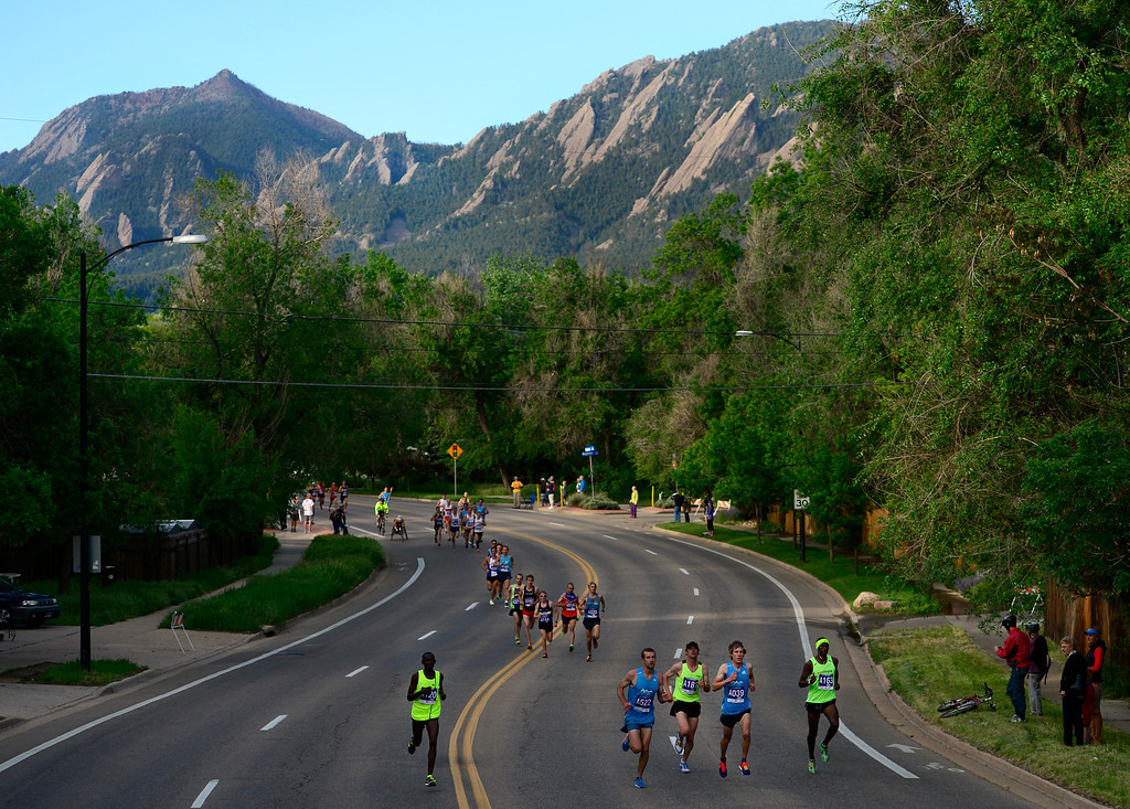 . The leaders in the BolderBoulder A Wave race make their way throughout the streets of Boulder. The 36th BolderBoulder takes place on the streets of Boulder, CO on Memorial Day, May 26, 2014. The 10K event brings winds through the streets of Boulder and finishes at Folsom Field on the University of Colorado campus. (Kathryn Scott Osler, The Denver Post)