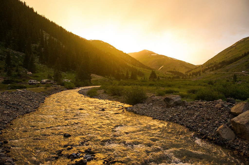 . SILVERTON, CO - JULY 11: The sun sets over the Grouse Gulch aid station at mile 58.4 of the Hardrock 100 Endurance Run on July 11, 2014, in the San Juan Mountains, Colorado. The 100.5-mile run hits trails and mountain passes between Silverton, Telluride, Ouray and Lake City. (Photo by Daniel Petty/The Denver Post)