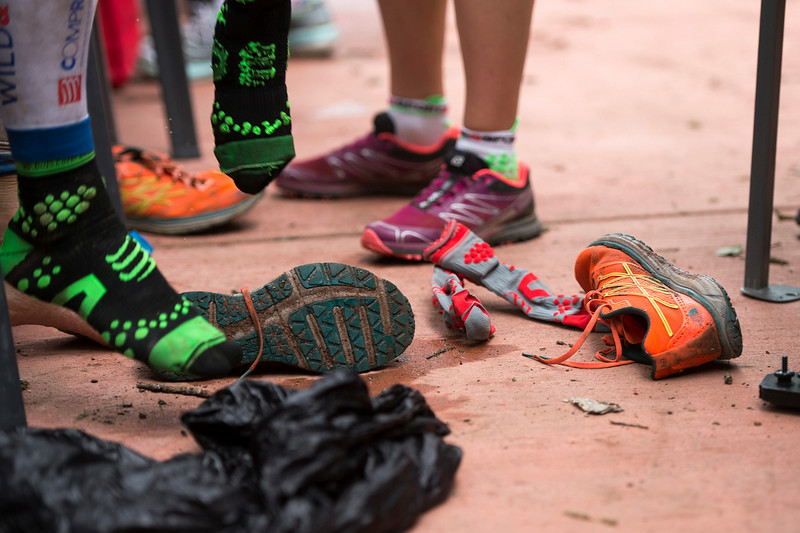 . Sebastien Chaigneau changes out his shoes and socks at the Telluride Aid Station in Town Park near mile 28 of the the Hardrock 100 Endurance Run on July 11, 2014, in the San Juan Mountains in Telluride, Colorado. Chaigneau won the 100-mile race in 2013. (Photo by Daniel Petty/The Denver Post)