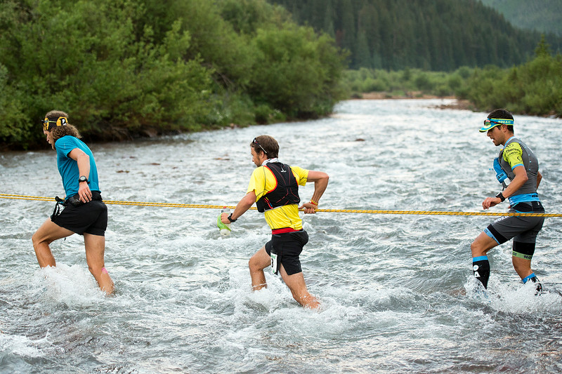 . From left, ultrarunners Joe Grant, Adam Campbell and Julien Chorier cross Mineral Creek near the two-mile mark of the 100.5-mile Hardrock 100 Endurance Run on July 11, 2014, in the San Juan Mountains near Silverton, Colorado. (Photo by Daniel Petty/The Denver Post)