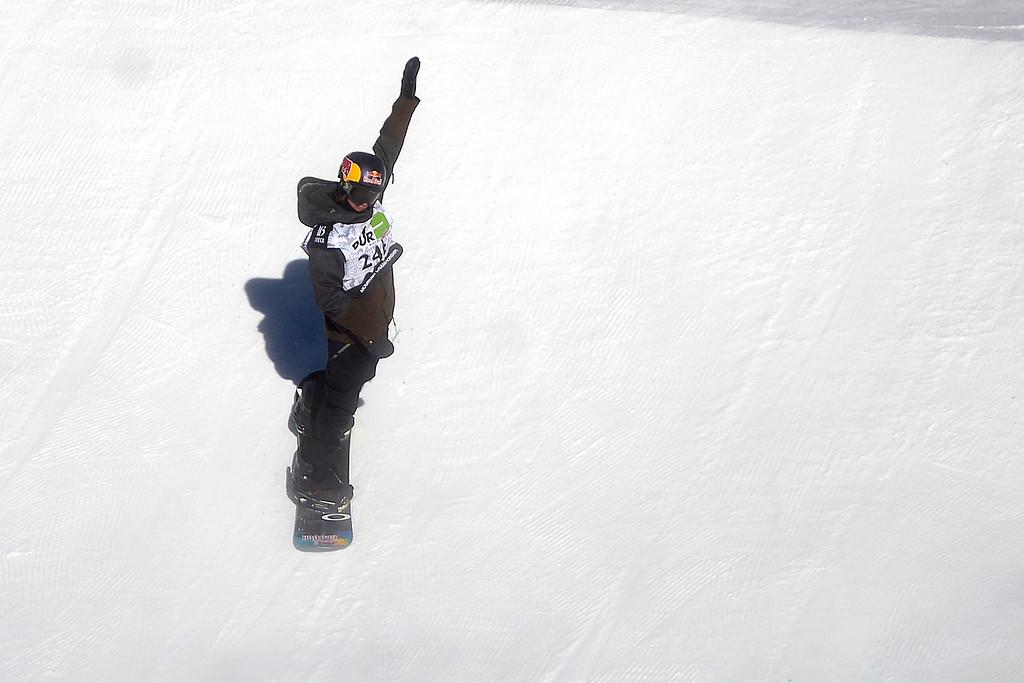 . Nikolas Baden holds his hand up after falling during the men\'s snowboard slopestyle at Breckenridge Ski Resort on Sunday, December 15, 2013. (Photo by AAron Ontiveroz/The Denver Post)i