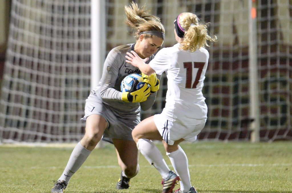 . DENVER, CO. - NOVEMBER 16: Annie Brunner of the University of Colorado (1) saves the goal from an attack by Kristen Hamilton of the University of Denver (17) during the NCAA women\'s soccer tournament first-round game at CIBER Field. November 16, 2013. CU won 1-0.  (Photo by Hyoung Chang/The Denver Post)