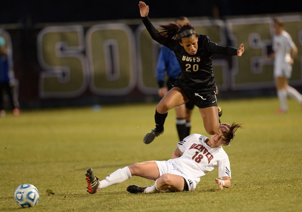 . DENVER, CO. - NOVEMBER 16: Francesca Garzelloni of the University of Denver(18) steals the ball from Brianna Hooks of the University of Colorado (20) during the NCAA women\'s soccer tournament first-round game at CIBER Field. November 16, 2013. (Photo by Hyoung Chang/The Denver Post)