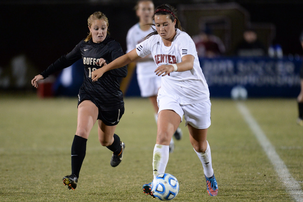 . DENVER, CO. - NOVEMBER 16: Nicolette DiGiacomo of the University of Denver (7) controls the ball against Carly Bolyard of the University of Colorado (12) during the NCAA women\'s soccer tournament first-round game at CIBER Field. November 16, 2013. November 16, 2013. CU won 1-0. (Photo by Hyoung Chang/The Denver Post)