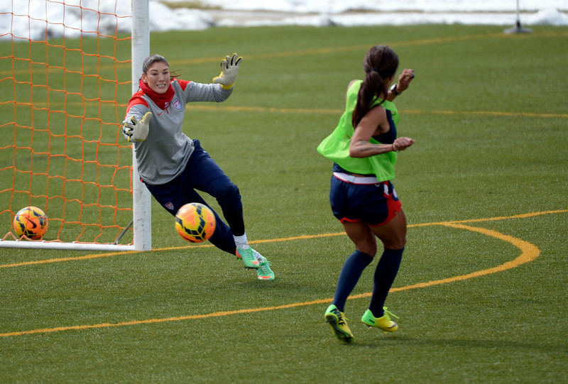 . GOLEN, CO - APRIL 03: Sydney Leroux FW of the USA women\'s soccer team takes a shot on goal as GK Hope Solo makes the attempt to save it  during their practice April 3, 2014 at the Colorado School of Mines as they prepare for their exhibition game against China at Dicks Sporting Goods Park.  (Photo by John Leyba/The Denver Post)