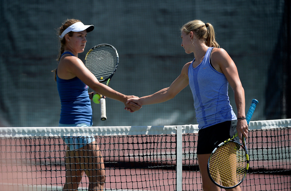 . DENVER, CO. - JUNE 23:  Erin Gebes (L) shakes hand with Lauren Strasburger after their Women\'s Finals in the Denver City Open at the Denver Tennis Club JUNE 23, 2013. Gebes was defeated by Strasburger 1-6, 6-2, 6-3 in their finals. (Photo By John Leyba/The Denver Post)