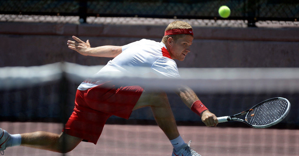 . DENVER, CO. - JUNE 23:  Mads Hegelund hits his return shot during his match against Richard Johnson in the Men\'s Finals in the Denver City Open at the Denver Tennis Club June 23, 2013. Hegelund defeated Johnson 6-2, 3-6, 6-4 to win the Finals. (Photo By John Leyba/The Denver Post)