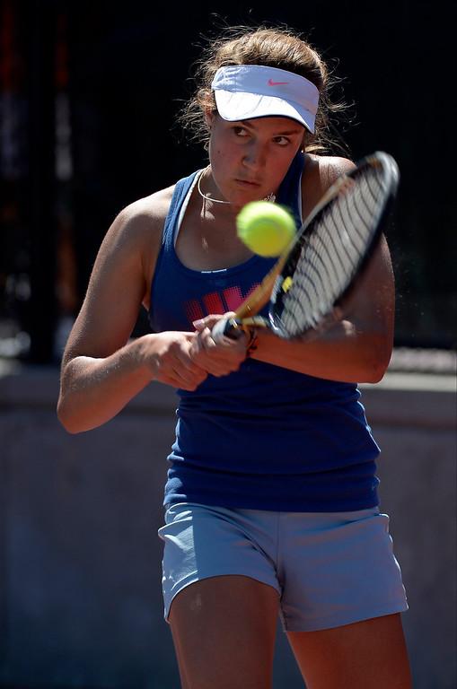 . DENVER, CO. - JUNE 23:  Erin Gebes hits her return shot back Lauren Strasburger during the Women\'s Finals in the Denver City Open at the Denver Tennis Club JUNE 23, 2013. Gebes was defeated by Strasburger 1-6, 6-2, 6-3 in their finals. (Photo By John Leyba/The Denver Post)