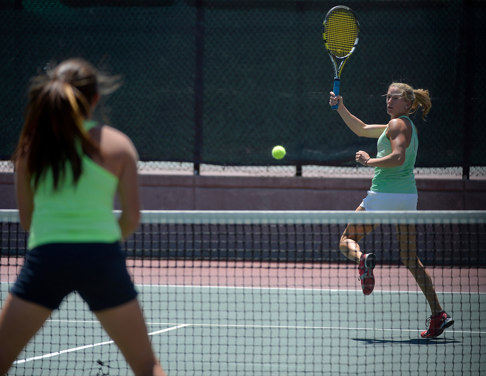 . DENVER, CO. - JUNE 23:  Lauren Strasburger (R) hits a return shot back to Meagan Monaghan during their doubles match Finals in the Denver City Open at the Denver Tennis Club JUNE 23, 2013. (Photo By John Leyba/The Denver Post)