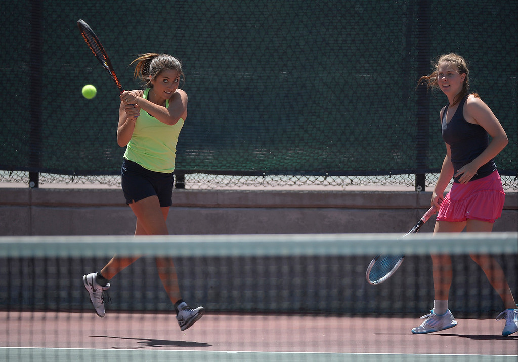 . DENVER, CO. - JUNE 23:  Meagan Monaghan  hits her return shot as Alex Middleton looks on during their doubles finals match in the Denver City Open at the Denver Tennis Club JUNE 23, 2013.  Strasburger, Johnson defeated Middleton/ Monaghan 6-2. 6-4. (Photo By John Leyba/The Denver Post)