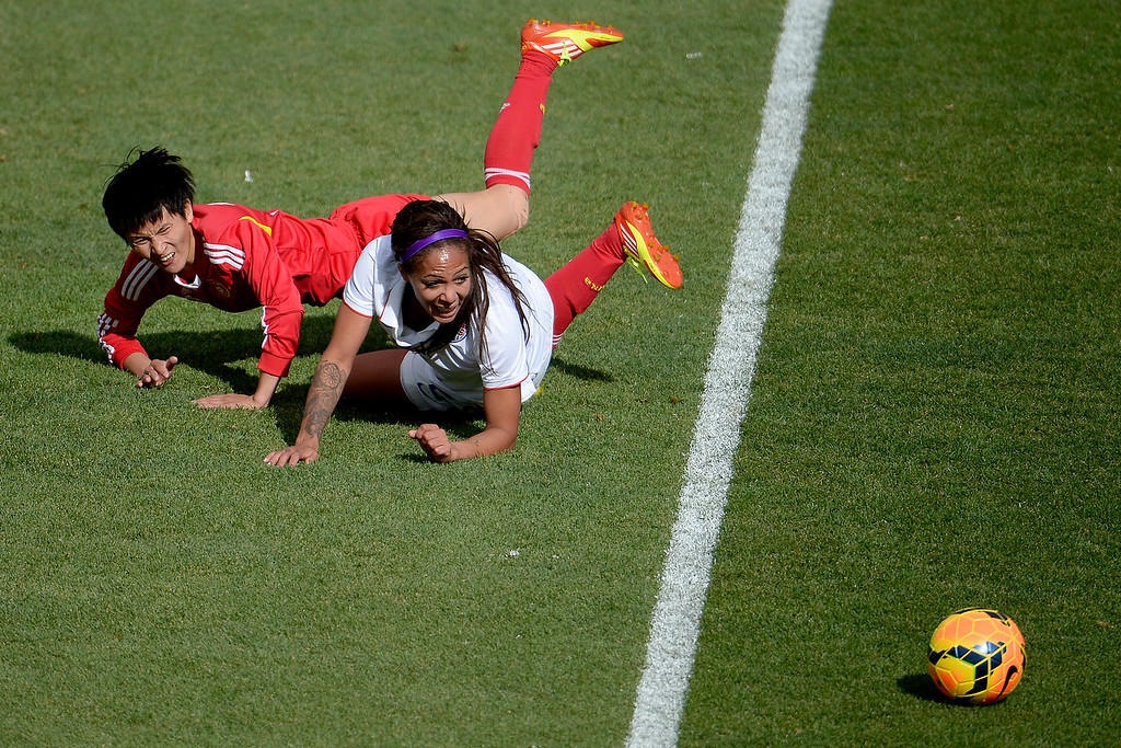 . Wang Shanshan (14) of China and Sydney Leroux (2) of the U.S.A. collide during the second half of the U.S.A.\'s 2-0 win. Dick\'s Sporting Goods Park on Sunday, April 6, 2014. (Photo by AAron Ontiveroz/The Denver Post)
