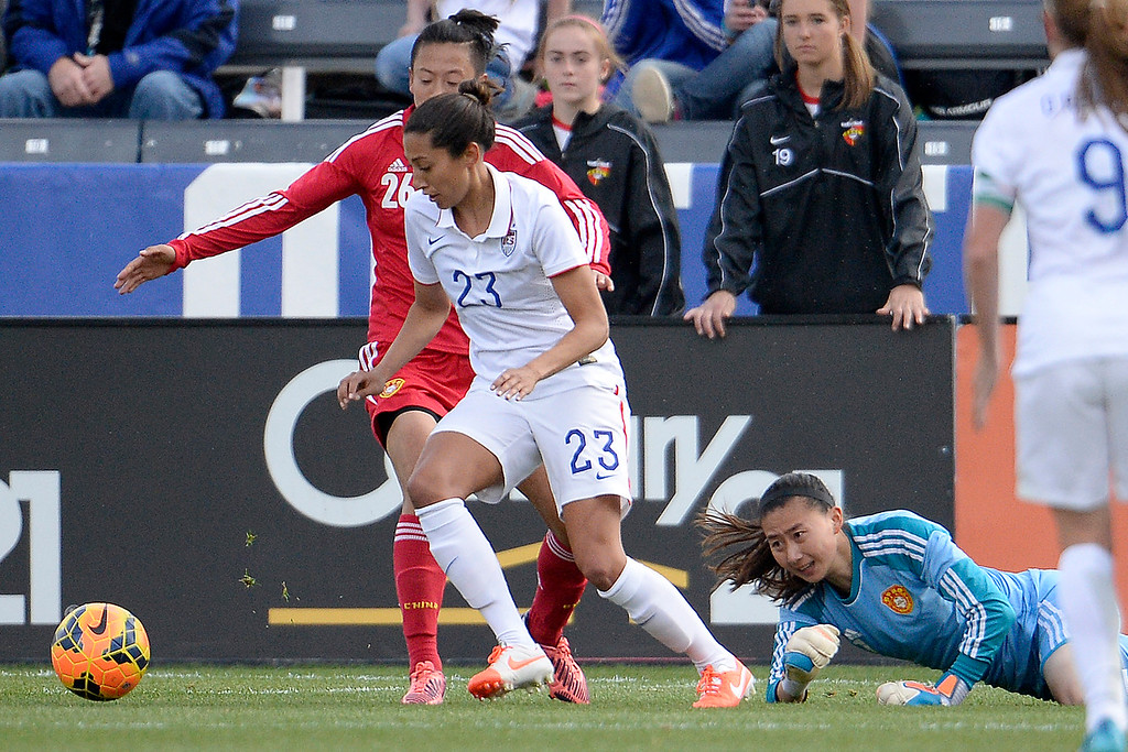 . Zhang Yue (1) of China watches as Christen Press (23) of the U.S.A. dribbles the ball towards an open goal during the first half of women\'s soccer action. Dick\'s Sporting Goods Park on Sunday, April 6, 2014. (Photo by AAron Ontiveroz/The Denver Post)
