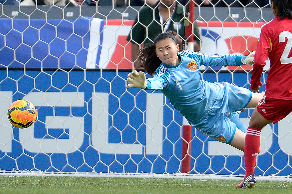 . Zhang Yue (1) of China stops a shot against the U.S.A. during the first half of women\'s soccer action. Dick\'s Sporting Goods Park on Sunday, April 6, 2014. (Photo by AAron Ontiveroz/The Denver Post)
