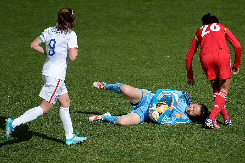 . Zhang Yue (1) of China clutches the ball after taking it from Abby Wambach (20) of the U.S.A. in the box during the second half of the U.S.A.\'s 2-0 win. Dick\'s Sporting Goods Park on Sunday, April 6, 2014. (Photo by AAron Ontiveroz/The Denver Post)