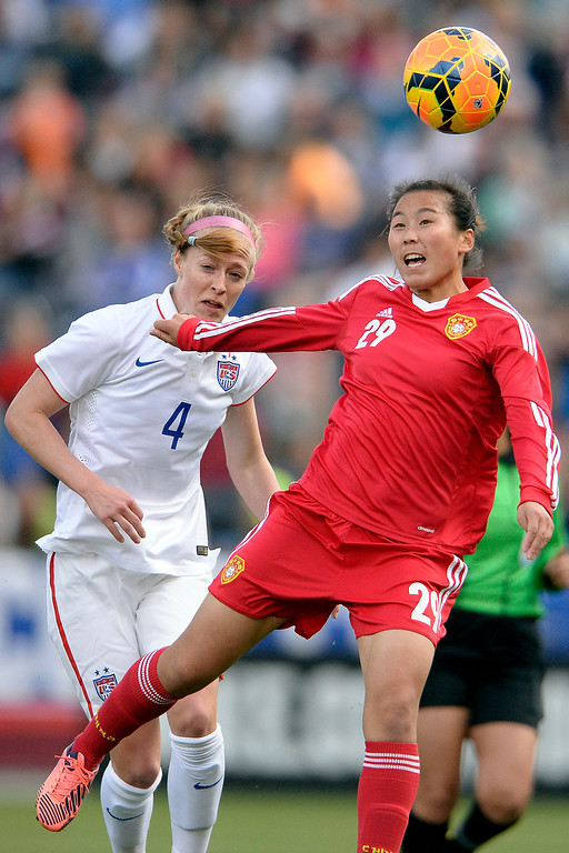 . Yang Li (29) of China heads the ball away from Becky Sauerbrunn (4) of the U.S.A. during the first half of women\'s soccer action. Dick\'s Sporting Goods Park on Sunday, April 6, 2014. (Photo by AAron Ontiveroz/The Denver Post)