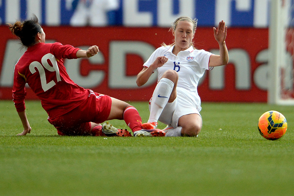 . Yang Li (29) of China defends Whitney Engen (6) of the U.S.A. during the second half of the U.S.A.\'s 2-0 win. Dick\'s Sporting Goods Park on Sunday, April 6, 2014. (Photo by AAron Ontiveroz/The Denver Post)