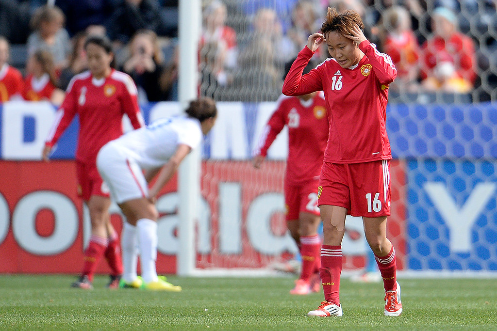 . Wang Chen (16) of China reacts after Carli Lloyd (10) of the U.S.A. narrowly missed a shot on goal during the first half of women\'s soccer action. Dick\'s Sporting Goods Park on Sunday, April 6, 2014. (Photo by AAron Ontiveroz/The Denver Post)